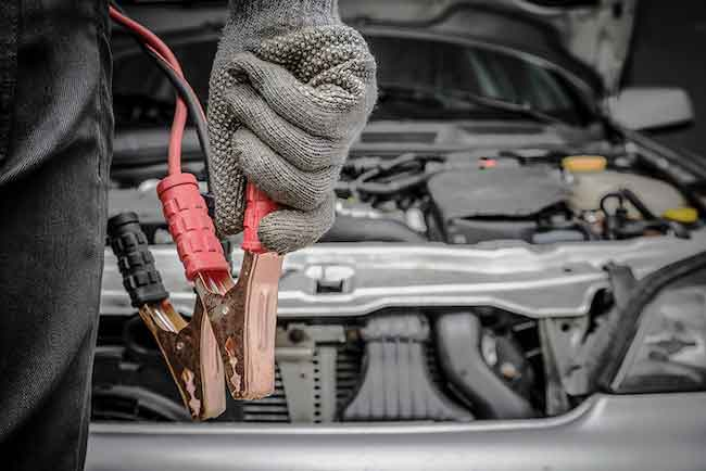 Image of dealer holding battery jump-starter