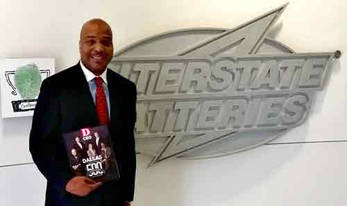 Photo of Kelvin Sellers in front of Interstate Batteries logo