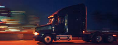 Heavy truck big rig driving at night with city lights in the background - heavy truck batteries